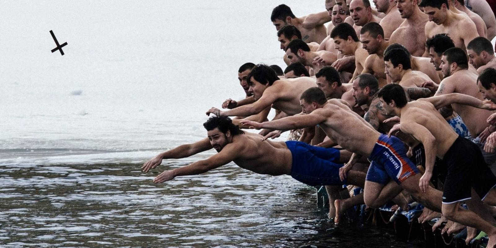Greeks dive for cross
