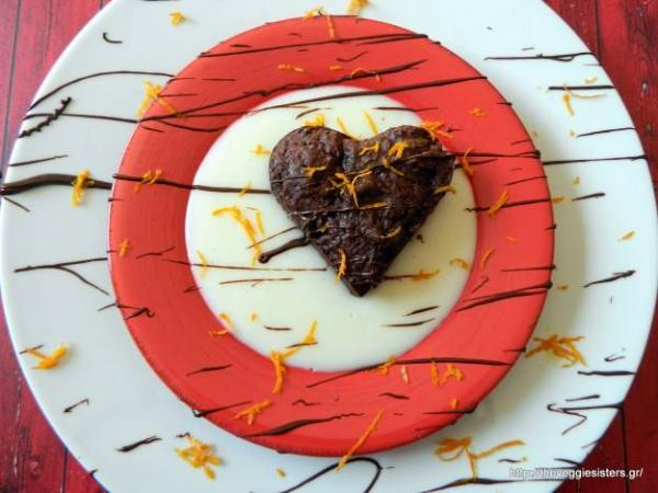 Vegan chocolate brownies heart with orange cream